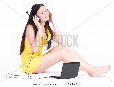 Teenage girl listen the music with computers PC