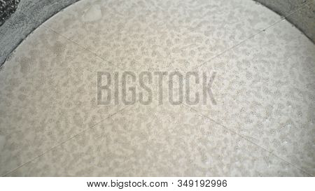 White Floor In A Liquid State In A Bucket. The White Mixture Is The Liquid Floor In The Bucket. Spre