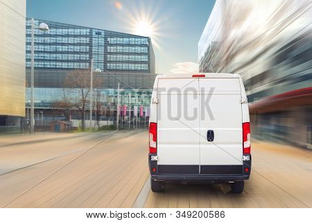 Small Cargo Delivery Van Driving In European City Central District. Medium Lorry Minivan Courier Veh