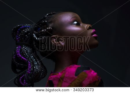 Emotional Portrait African Woman With Closed Eyes Fashionable Make Up And Hairstyle In Studio. Dark-