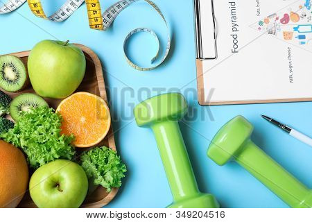 Fruits, Dumbbells, Measuring Tape And List Of Products On Light Blue Background, Flat Lay. Visiting