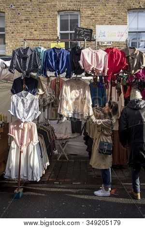 London, Uk, - 23 December 2019, Visitors Look At Clothing At The Brick Lane Street Market. Girl And