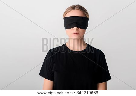 Blindfolded Young Woman In Black T-shirt Isolated On White, Human Rights Concept