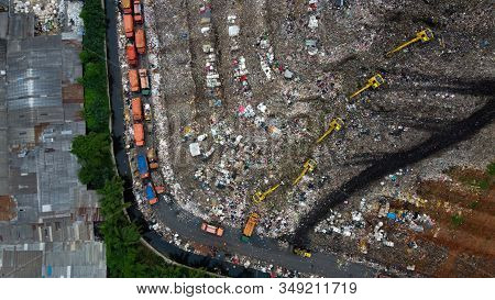 Aerial View. Large Landfills Like Mountains. The Tractor Take Garbage On Landfills At Bekasi - Indon