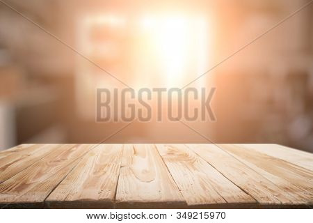 Wooden surface on blurred background of window in apartment.