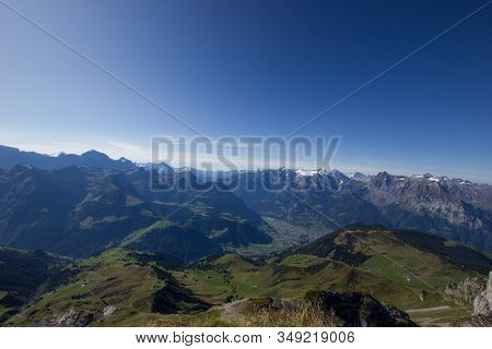 Reuss Valley On A Sunny Day With Mountains In The Background In Central Switzerland