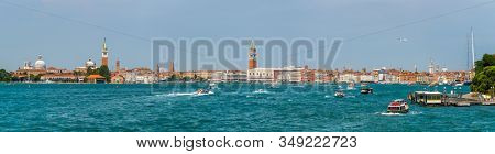 Venice, Italy - August 3, 2019: Tourists sightseeing in Venice's most famous square San Marco view from boat in Grand Canal, panorama