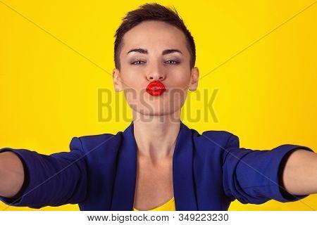 Blowing A Kiss, Selfie Shot. Closeup Woman Short Hair Girl Puckering Lips For A Virtual Kiss While D