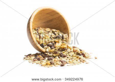 Healthy cereal breakfast. Mixed muesli in bowl isolated on white background.