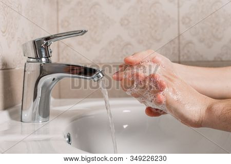 Hygiene Concept. Washing Hands With Soap Under The Tap With Water. Handsome Male Hands And Water In