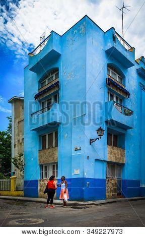 Havana, Cuba, July 2019, Two Women Talking Outside A Blue Building In Calle Muralla In The Oldest Pa
