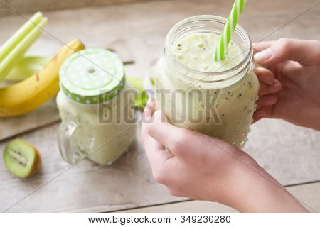 Green Vegetable Smoothie, Healthy Eating Concept. Close Up Of Green Vegetable Detox Smoothie With Ce