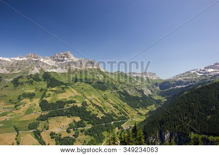 Sunny Summer Day With View Over The Schaechental In Switzerland
