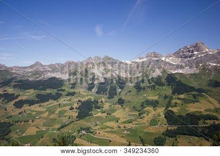 Swiss Mountains On A Sunny Summer Day In Central Switzerland