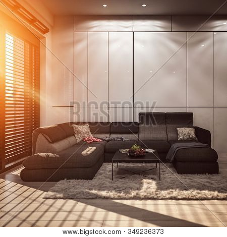 Modern living room with grey wall panels and wide cozy corner couch on fluffy carpet. Warm sunlight coming from high window with horizontal blinds. 3d Rendering