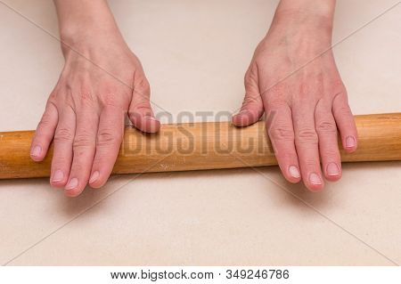 Female Cook Rolling Dough With Rolling Pin. Food Preparation.