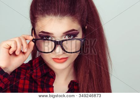 Confused Skeptical Woman Thinking Looking At You With Disapproval Pulling Down Her Eye Glasses Skept