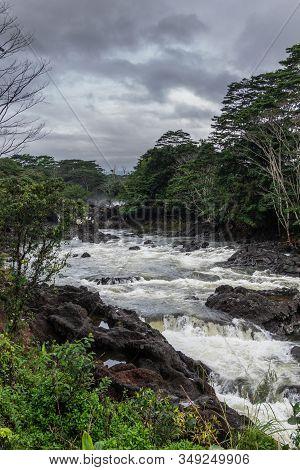 Hilo, Hawaii, Usa. - January 14, 2020: Wailuku River Surrounded By Green Trees And Plants Above Rain