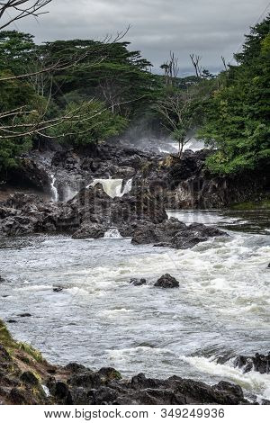 Hilo, Hawaii, Usa. - January 14, 2020: White Water Of Wailuku River Surrounded By Green Trees And Pl