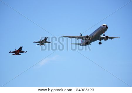Airbus A320 aircraft accompanied by two fighters F16