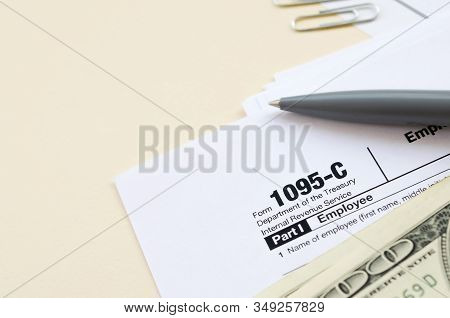 Irs Form 1095-c Employer-provided Health Insurance Offer And Coverage Tax Blank Lies With Pen And Ma