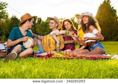 Group Of Young Friends Having Fun On Picnic Party.
