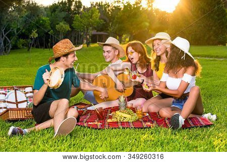Friends Singing On Picnic Party.