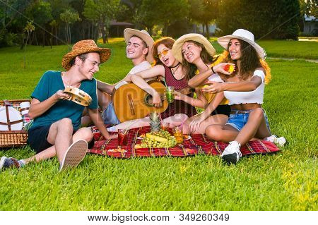 Happy Young Friends Having Picnic.
