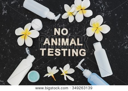 Cruelty-free Beauty, No Animal Testing Message Among Lotions And Cosmetic Products On Black Marble D