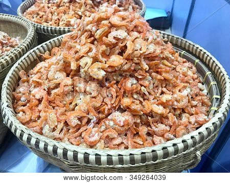 Pile Of Fresh Organic Dried Shrimp In Woven Basket In Marketplace