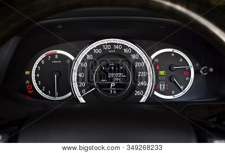 Car Speedometer With Kilometer Per Hour And Tachometer,fuel Meter,odometer And Warning Light On A Ca