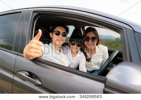 Happy Asian Family With Father Thumb Up And Mother And Daughter Wear Sunglass In Compact Car Are Smi