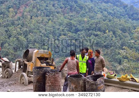 Tinchuley, Darjeeling, West Bengal, India- December 25, 2019: Men Working At The Construction Road I