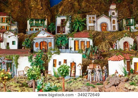 Candelaria, Tenerife, Spain - December 12, 2019: Christmas Belen -  Creche, Nativity Scene, statuette of people and houses in miniature
