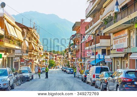 Kalabaka, Greece - September 18, 2019:  Street with sops and parked cars in Kalabaka town