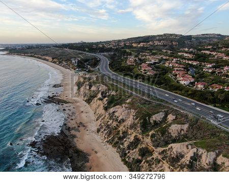 Aerial View Of Newport Beach, Cliff And Beach During Sunset Twilight In Southern California, Usa