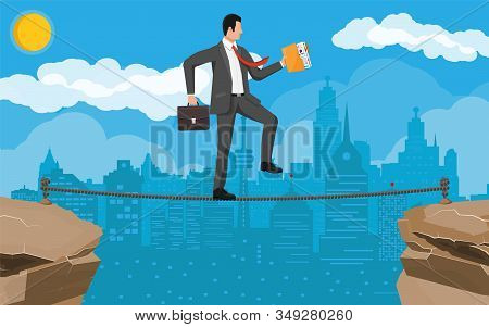 Businessman In Suit Walking On Rope With Suitcase And Folder. Business Man Walking On Tightrope Gap.