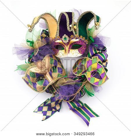 Mardi Gras Wreath Isolated On White Background With Mardi Gras Mask. Top View
