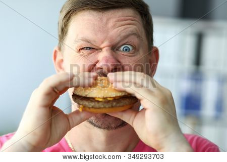 Championship On Eating Burgers, High-speed Eating. Hunger, Daily Human Diet. An Experiment With Qual