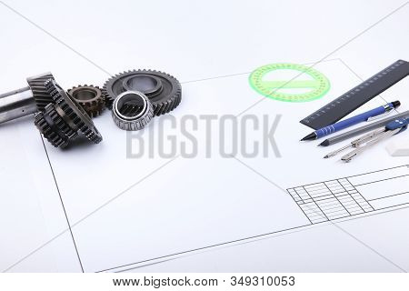 Backdrop With Drafting Accessories, Drafting Paper And Metal Gears With Copy Space