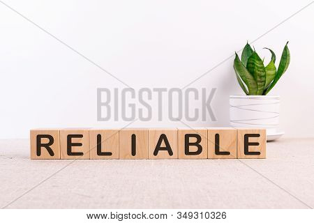 Reliable Word Made With Building Blocks On A Light Background