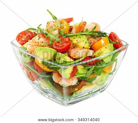 Salad With Avocado, Shrimp, Fresh Cherry Tomatoes And Arugula In Glass Bowl Isolated On White Backgr