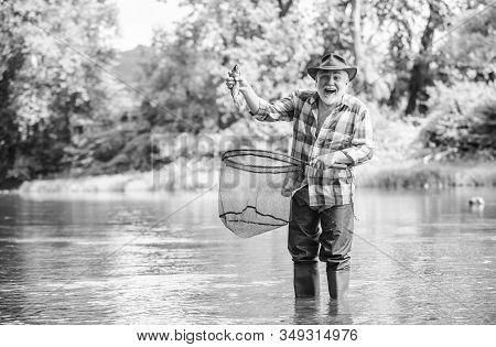 Fisherman Fishing Equipment. Hobby Sport Activity. Pensioner Leisure. Fish Farming Pisciculture Rais