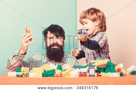 Playroom. Father And Son Play Game. Little Boy With Bearded Man Dad Playing Together. Child Developm