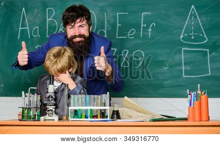 Teacher Bearded Man Father And Child Test Tubes. Study Chemistry Together. Boys Only. Personal Examp