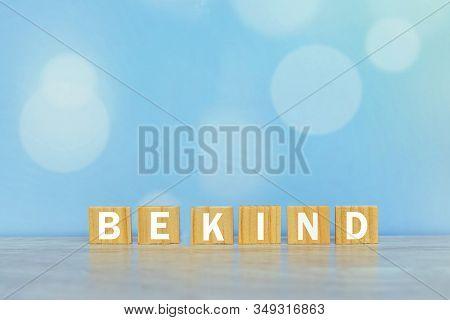 Inspirational Words On Wooden Blocks - Be Kind. On Vintage Soft Blue Bokeh Background. Kindness Moti