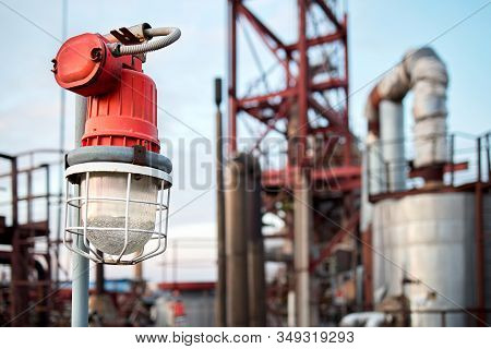 Lighting Mast With Lantern In Explosion-proof And Fire-proof Design Close-up Over Background Of Pipe