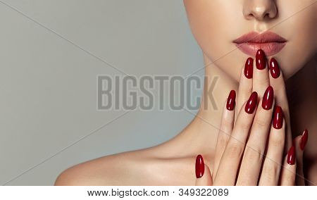 Beautiful Girl   . Model Woman Showing  Red  Shellac Manicure On Nails   . Cosmetics ,beauty And Mak