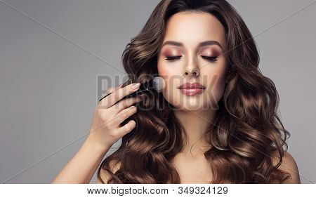 Makeup Artist Applies  Makeup Artist Applies   Applies Powder And Blush  . Beautiful Woman Face. Han