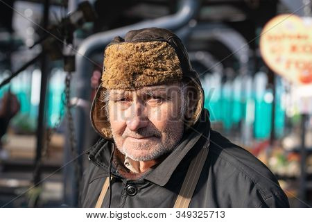 Belgrade, Serbia - 15.1.2020. Old Man Portrait On Market. Pensioner Lifestyle. Real Life Photo Of Ol